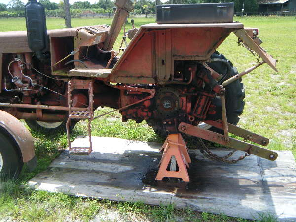 Belarus: How-do-I-get-this-part-off-the-tractor-so-I-can-install-a-new-one