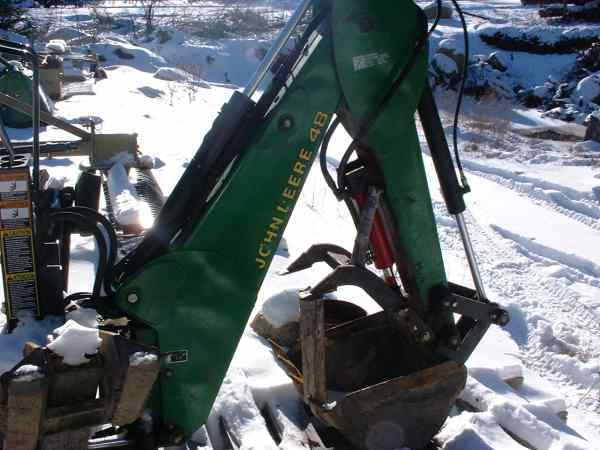 JD #48 backhoe with a fabricated hydraulic thumb. Most helpful add-on I ever did.