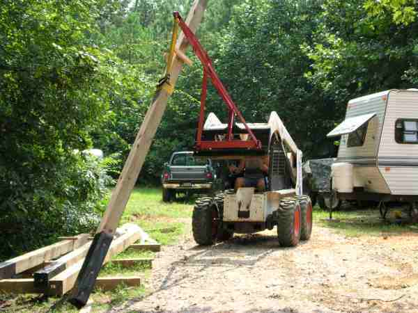 I used a 3 PH hitch adapter and my boom pole to lift the 6x6 poles into position.  This arrangement has become very handy for loading and unloading stuff from the truck and trailer.
