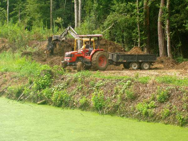 M6800 Kubota and EC45 Volvo moving dirt. Note Duck Weed on pond!