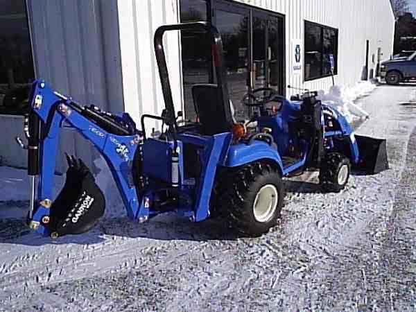 2004 New Holland TZ24DA with a sub fram mounted Woods ground breaker X back hoe and 10 la loader. <br>