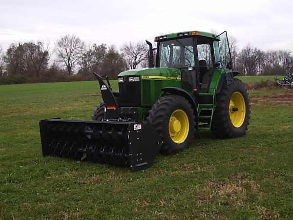02 John Deere 7810 With a front mount Rear pto driven snow blower.