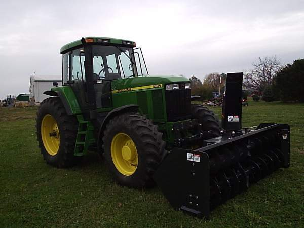 02 John Deere 7810 With a front mount Rear pto driven snow blower