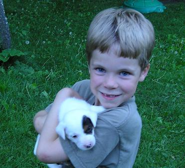 Our new Jack Russell pup at 5 weeks when we picked her out.  The boy is not my kid.